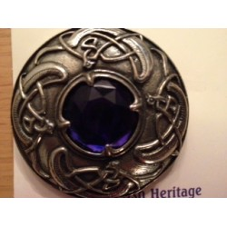 Pewter coloured brooch with coloured stone